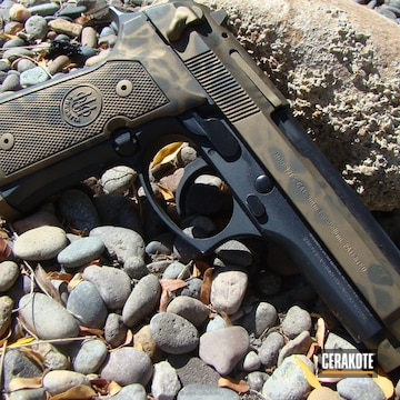 Cerakoted Beretta Handgun In A Cerakote Snake Skin Camo Finish