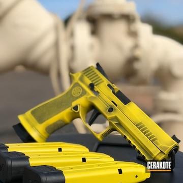 Cerakoted Distressed Yellow And Black Sig Sauer Handgun