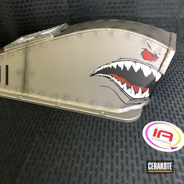 Cerakoted Custom Coated Part With A Fighter Plane Shark Mouth Graphic
