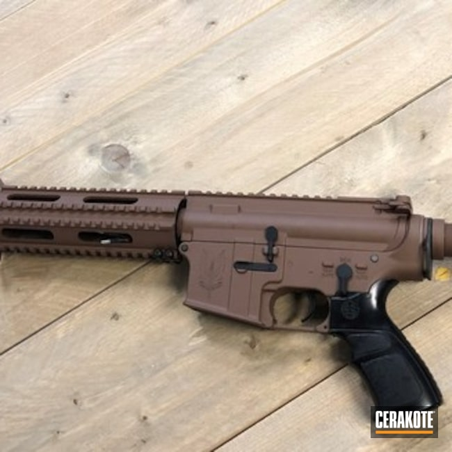 Airsoft ICS M4A1 replica done in Federal brown and Graphite Black