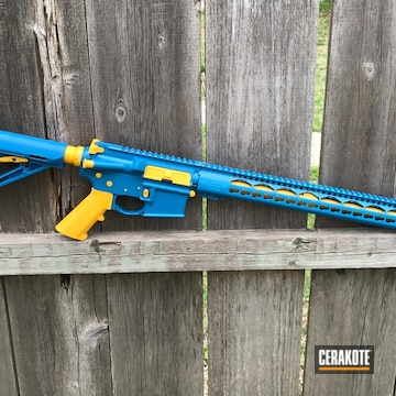 Cerakoted Two Toned Blue And Yellow Anderson Mfg. Rifle