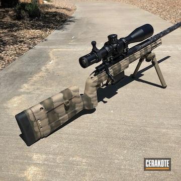 Cerakoted Krg Bravo Rifle With A Cerakote Freehand Camo Finish