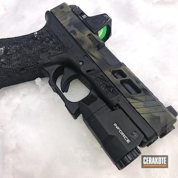 Cerakoted Glock 19 Handgun With A Cerakote Multicam Black Finish