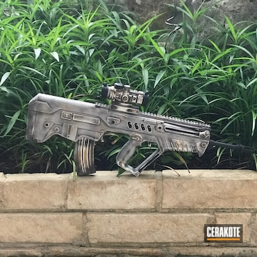 Cerakoted Iwi Tavor With A Cerakote Bone Themed Finish
