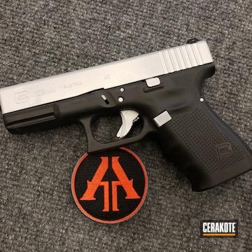 Cerakoted Glock 23 Handgun With A Satin Aluminum Cerakote Slide