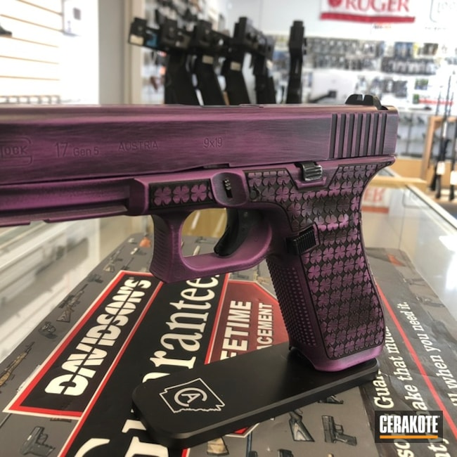 Battleworn Graphite Black and Bright Purple Glock 17 Handgun