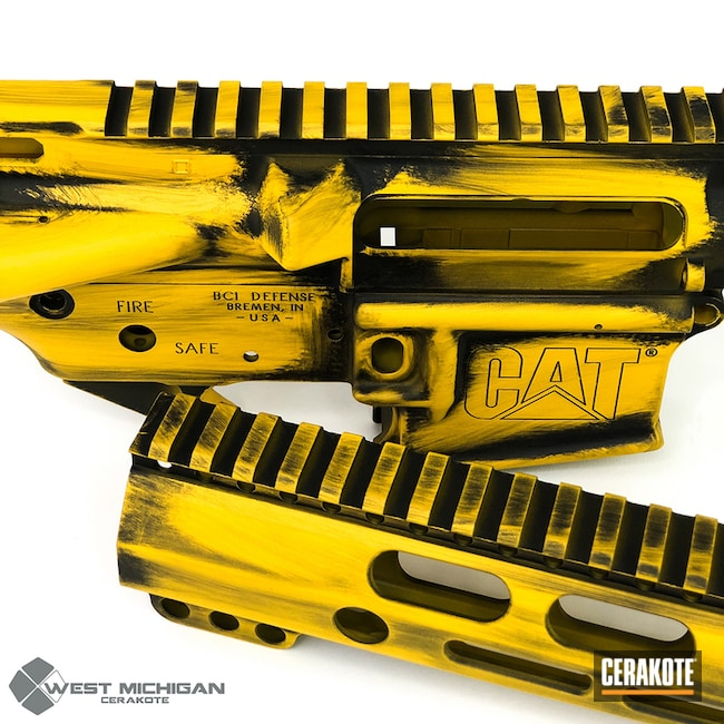 Custom Upper / Lower / Handguard in a Distressed Yellow and Black Cerakote Finish