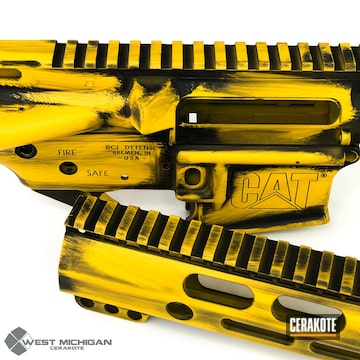 Cerakoted Custom Upper / Lower / Handguard In A Distressed Yellow And Black Cerakote Finish