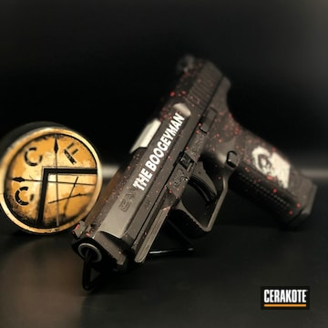 Cerakoted H-146 Graphite Black, H-216 Smith & Wesson Red And H-255 Crushed Silver