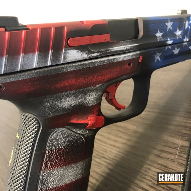 Thumbnail version of the 10th project picture. Graphite Black H-146Q, Smith & Wesson, Marine Corp Logo, American Flag, Pistol, Ridgeway Blue H-220Q, USMC Red H-167Q, Bright White H-140Q, Gold H-122Q, Marines, Texas Flag, Distressed American Flag, Distressed Texas Flag, 2 flags 1 pistol, Gun Coatings