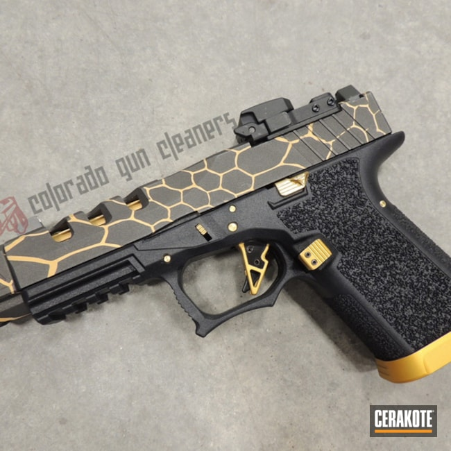 Polymer80 Handgun with a Black and Gold Cerakote Hex Camo Finish