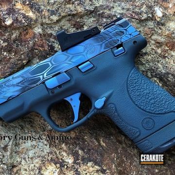 Cerakoted Smith & Wesson Handgun With A Blue Cerakote Kryptek Finish