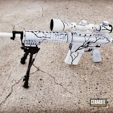 Cerakoted Bushmaster Ar-10 Rifle With A Cerakote Winter Camo Finish