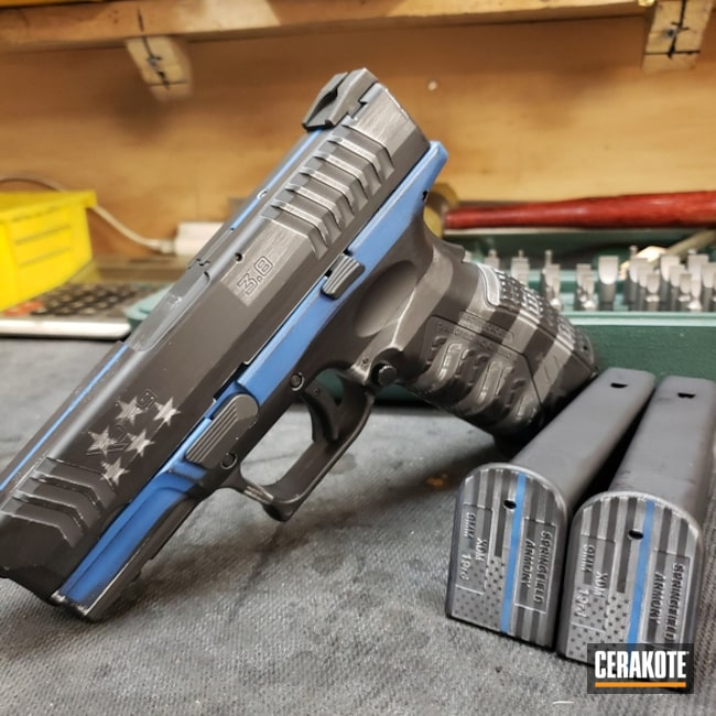 Springfield XDM with a Thin Blue Line American Flag Cerakote Finish