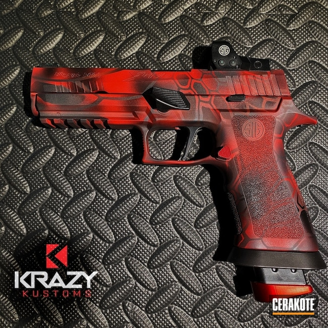 Sig Sauer P320 Handgun with a Red, Grey and Black Kryptek Finish
