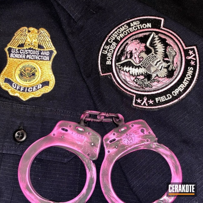 Battleworn Pink and Black Smith & Wesson Handcuffs