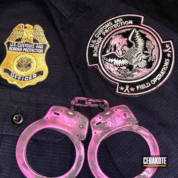 Cerakoted Battleworn Pink And Black Smith & Wesson Handcuffs