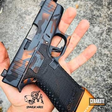Cerakoted Glock 43x Handgun With An Orange Multicam Finish