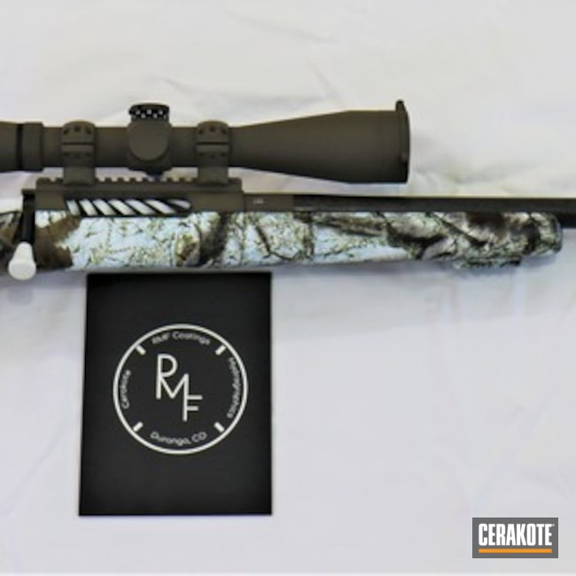 Cerakoted: S.H.O.T,Bolt Action Rifle,Hydrographics,Dolores River Rifles,Cerakote,Barrel,MATTE ARMOR CLEAR H-301,Scope,Snow White H-136,Custom Rifle Build,Gun Coatings,Action,Stock,Chocolate Brown H-258