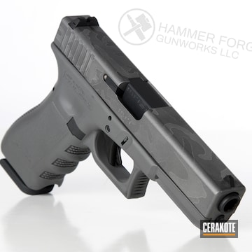 Cerakoted Glock Handgun With A Laser Camo Cerakote Elite Finish