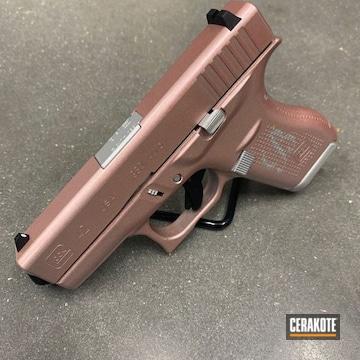 Cerakoted Glock 42 Handgun With A Gun Candy And Cerakote Rose Gold Finish