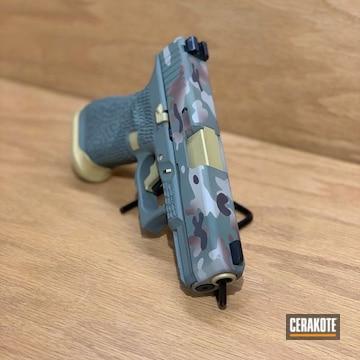Cerakoted Glock 19 Handgun With A Custom Cerakote Multicam Finish