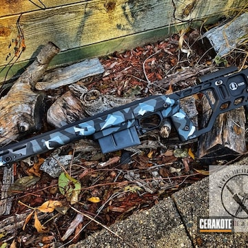 Cerakoted Rifle Chassis With An Urban Splinter Camo Cerakote Finish