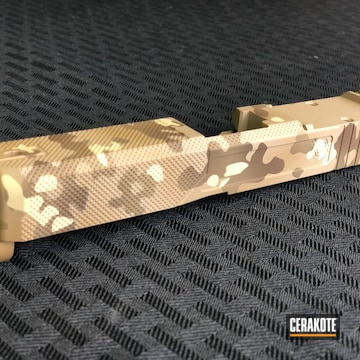 Cerakoted Glock Slide With A Custom Cerakote Desert Multicam Finish