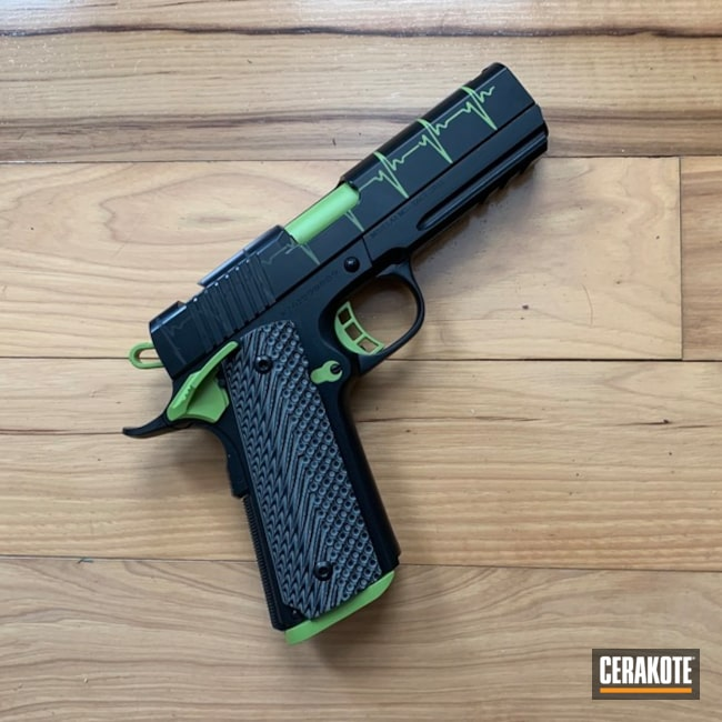 1911 Handgun with a E-100 and H-168 Cerakote Heartbeat Finish