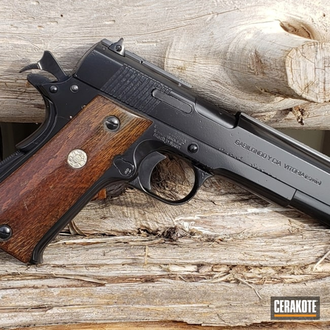 Refinished .45 ACP 1911 Handgun using Cerakote E-100 Blackout