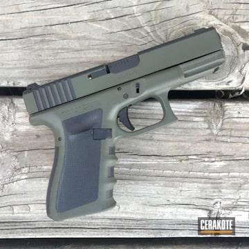 Cerakoted Two Toned Glock Handgun Using H-146 And H-231