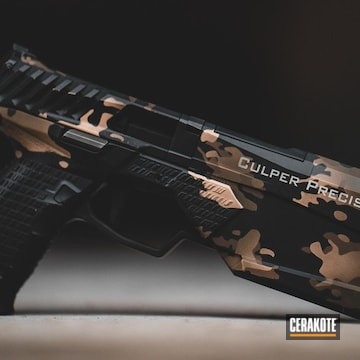 Cerakoted Silencerco Handgun With A Custom Cerakote Multicam Finish