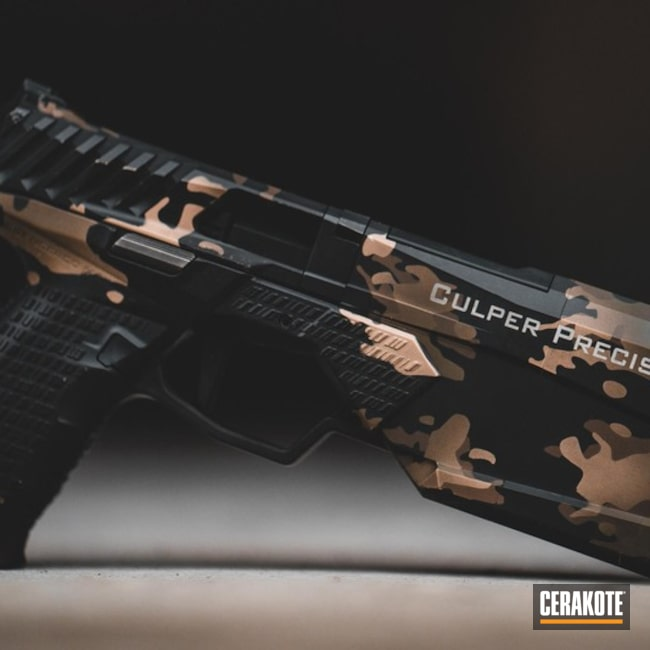 Cerakoted Silencerco Handgun With A Custom Cerakote Multicam Finish