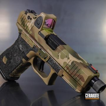 Cerakoted Custom Glock Handgun With A Cerakote Multicam Finish