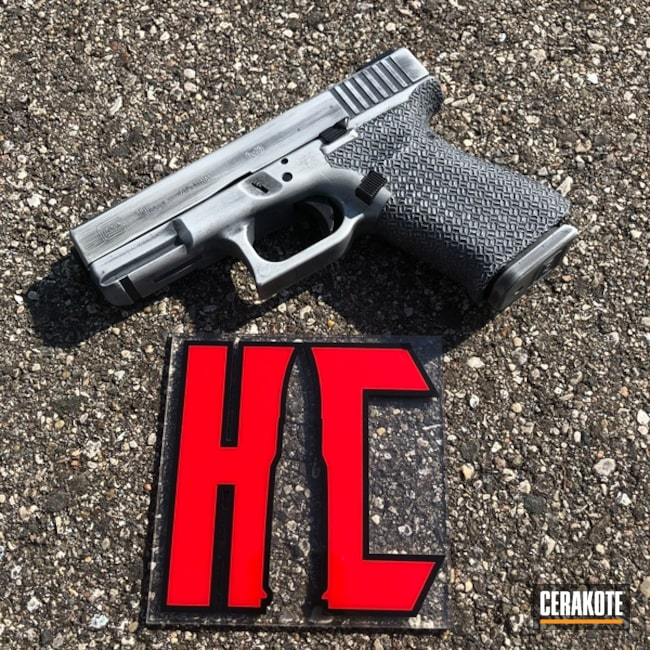 Glock 19 Handgun with a Battleworn H-213 and H-210 Cerakote Finish