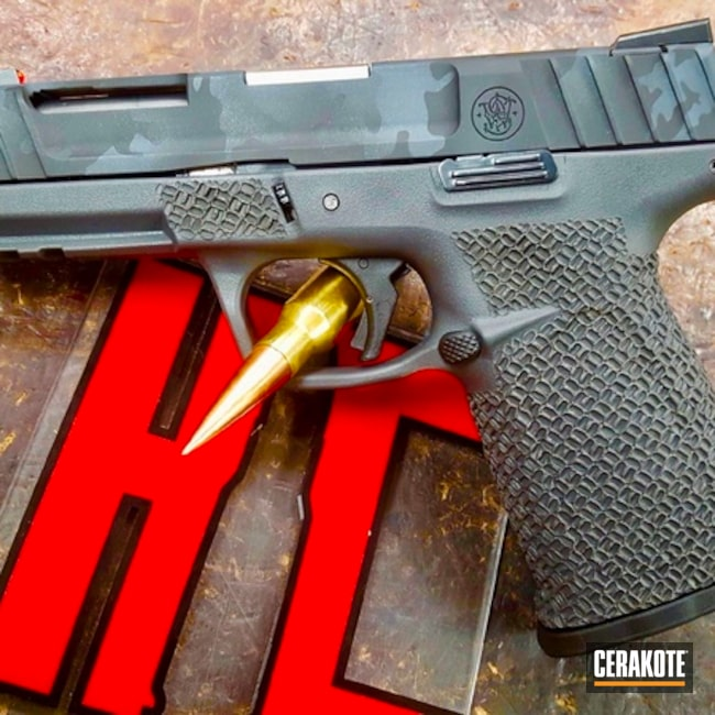 Smith & Wesson Handgun with a Cerakote H-214 and H-190 MultiCam Finish