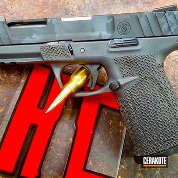 Cerakoted Smith & Wesson Handgun With A Cerakote H-214 And H-190 Multicam Finish