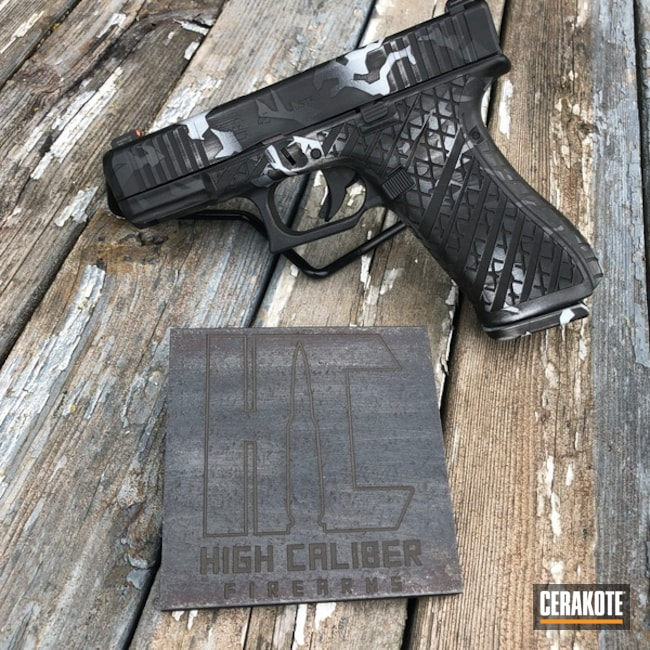 Laser Engraved Glock 45 Handgun with Custom Cerakote Splinter Camo Finish using H-146, H-213, H-237 and H-297