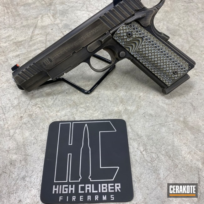 STI 1911 Handgun with a Cerakote H-267 and H-190 Battleworn Finish