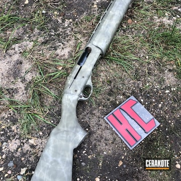 Cerakoted Shotgun With A Cerakote Freehand Camo Finish