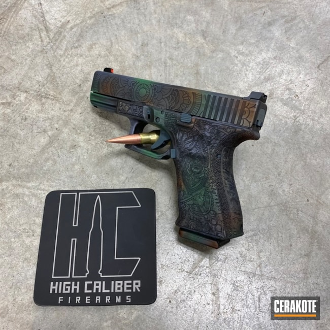 Laser Engraved Glock 19 Handgun with a MultiColor Cerakote Finish