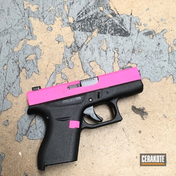 Cerakoted Glock 42 Handgun With A Cerakote H-141 Prison Pink Finish