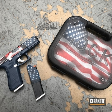 Cerakoted Glock 17 Handgun With An American Flag Cerakote H-190, H-140, H-221, H-151 And H-127 Cerakote Finish
