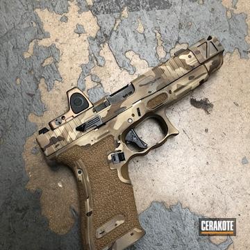Cerakoted Glock 19 Handgun With An Arid Multicam Cerakote Finish