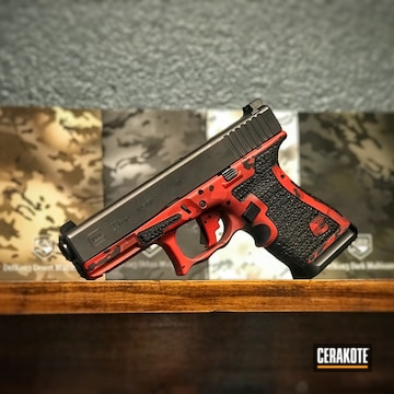 Cerakoted Glock 23 Handgun With A Red Cerakote Multicam Finish Using H-146, H-216, H-221 And H-234