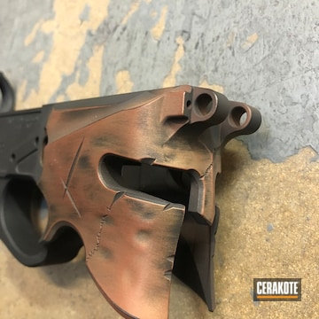 Cerakoted Battleworn Spartan Helmet With A Custom Cerakote H-148, H-190, H-122, H-149 And H-128 Patina Finish