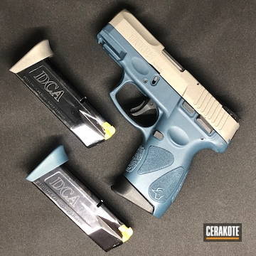 Cerakoted Two Toned Taurus Handgun In H-237 And H-185