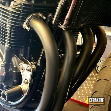 Cerakoted Black Honda Motorcycle Exhausts