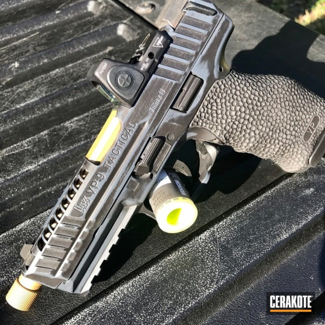 HK VP9 Handgun With Combat Grey, Graphite Black And Gold