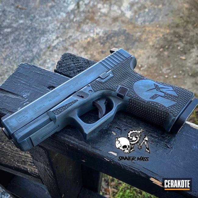 Cerakoted: S.H.O.T,Laser Stippled,Spartan,Distressed,Stippled,Pistol,Laser Engrave,EDC,Spartan Helmet,Handgun,Glock 19,Battleworn,Graphite Black H-146,Glock,Blue Titanium H-185